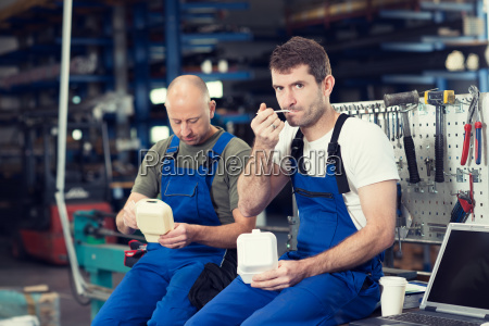two worker in factory have a