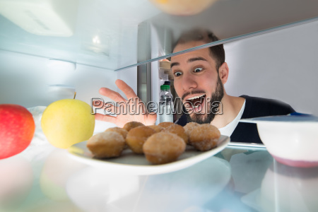 excited man looking at cookie