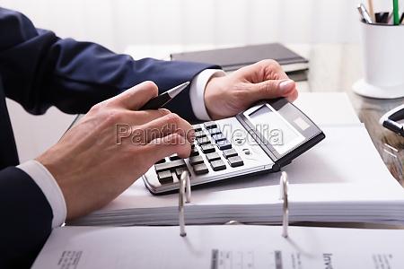 businessperson calculating bill
