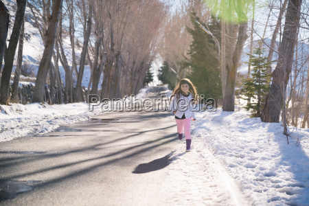 little girl running in the park