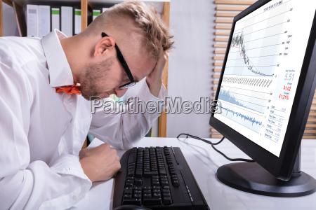 stressed business man in front of
