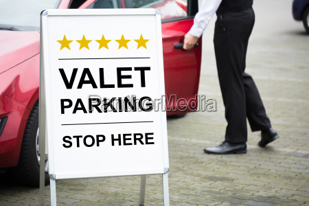 young male valet standing near valet