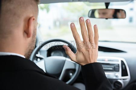 man sitting on self drive car