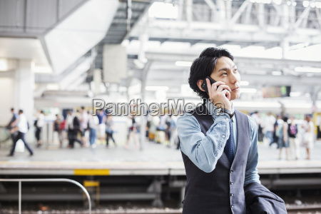 businessman wearing suit standing on train