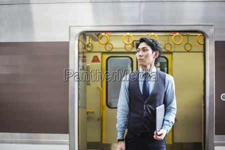 businessman wearing blue shirt and vest