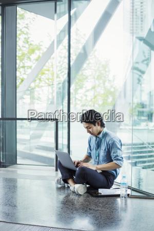 businessman wearing blue shirt sitting on