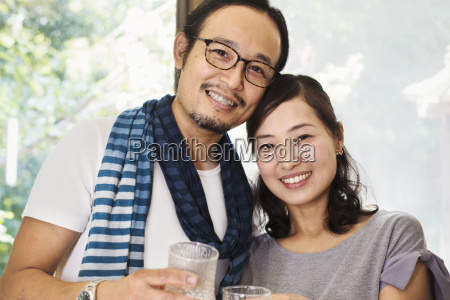 portrait of smiling woman and man