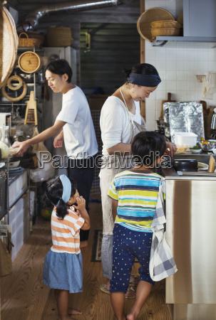 man woman wearing apron boy and