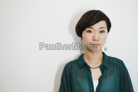woman with short black hair wearing
