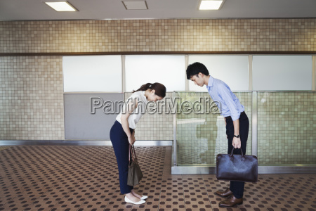 two people greeting a man and
