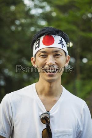 portrait of man wearing headband