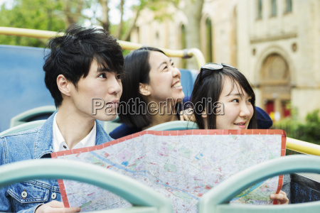 smiling man and two women with
