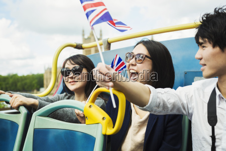 smiling man waving union jack flag