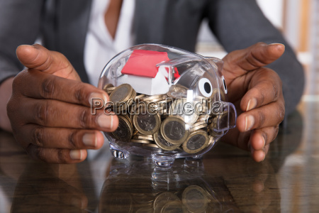 human hand protection piggy bank with