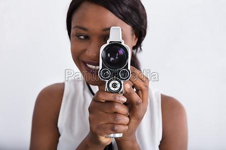 woman looking through lens of retro