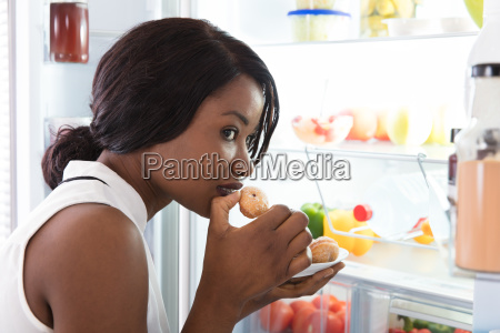 close up of a woman eating