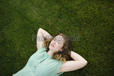 woman lying on grass and sleeping