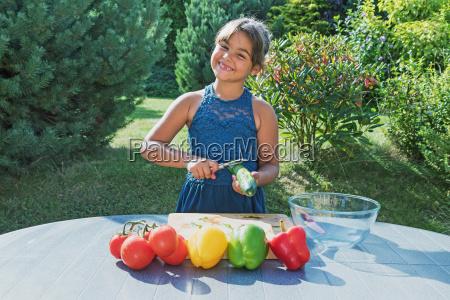 portrait of smiling little girl preparing