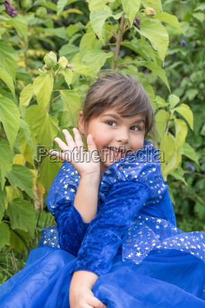 portrait of little girl making a