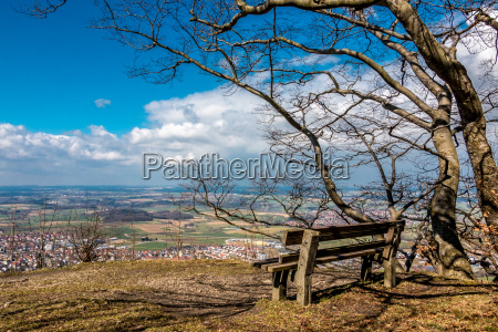 lonely bench on a hill with