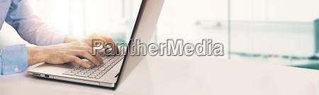 modern businessman typing on laptop keyboard