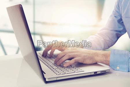 modern businessman working on laptop in