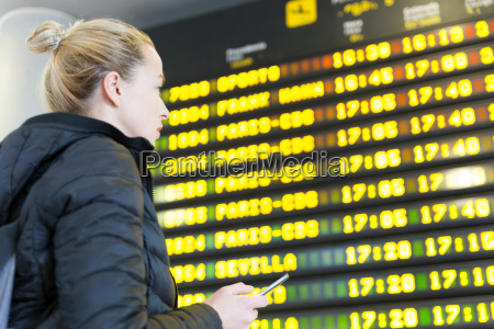woman at airport in front of