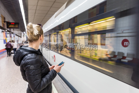 woman with a cell phone waiting