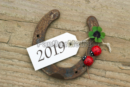 new years card with horseshoe leafed