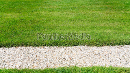 pebble road on green lawn
