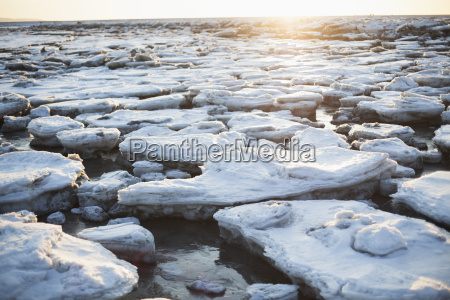 ice chunks on a beach in