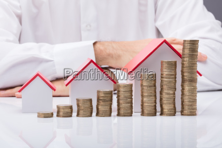 businessman with different size houses and