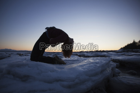 woman practices yoga on an ice