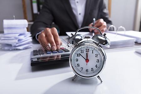 businessperson using calculator for calculating bill