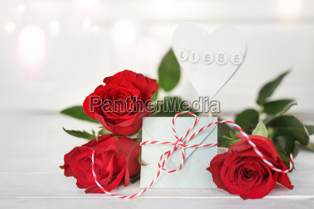 red roses with a message of