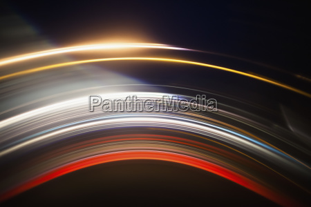 various abstract light trails against black