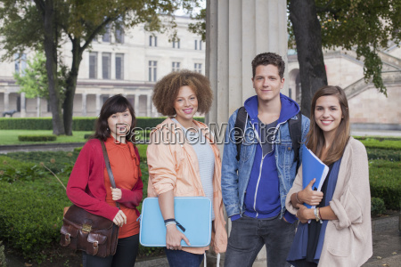 portrait of young friends standing against