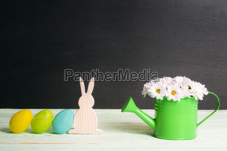 easter bunny and eggs with daisies