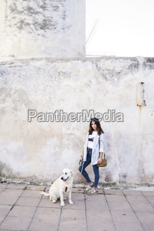 young woman with her dog on