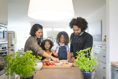 happy family baking pizza at home