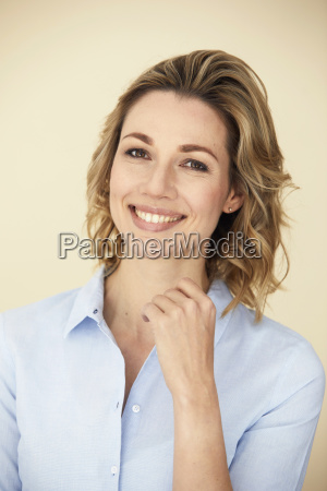 portrait of blond woman smiling business