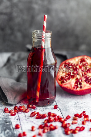 glass bottle of pomegranate juice and
