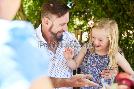 happy girl with father sitting at