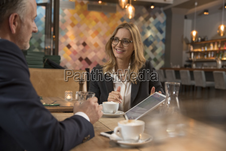 two business people having meeting in