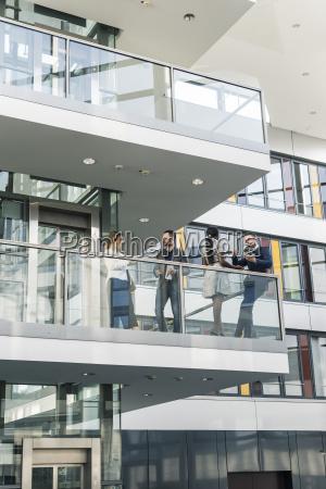business people talking on office floor