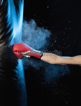 cropped image of man hitting punching
