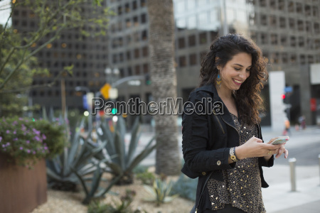 smiling mid adult woman using mobile