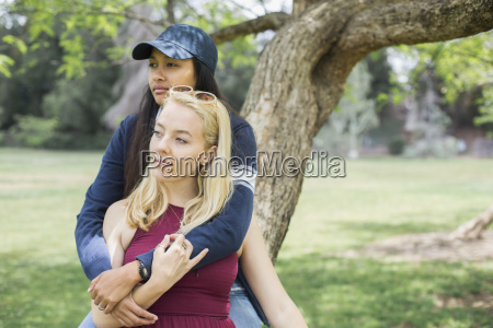 two young women sitting together on