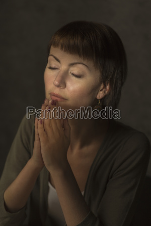 mid adult woman with closed eyes