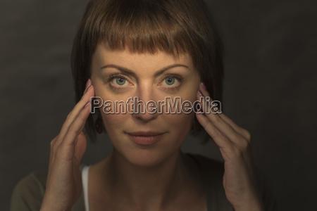 portrait of mid adult woman meditating